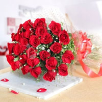 There is no better way of expressing your emotions than a bouquet of flowers. Ravishing Red 18 Red Roses Bunch
