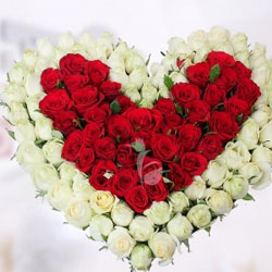 brilliant heart-shape arrangement of 40 red roses surrounded by 60 white roses, which makes it a total of 100 beautiful fresh roses, Flowers to Bangalore