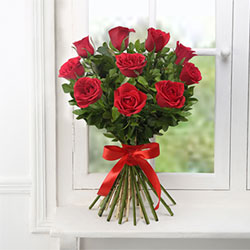 12 Long Stem Red Roses decorated with green leaves to your loved ones in India , Flowers to Bangalore