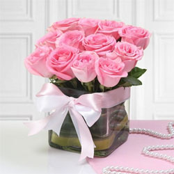 Spread positive vibes around and convey your regards with this gorgeously arranged featuring a Glass Vase of 12 Pink Roses.