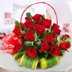 This is a basket of 30 Red Roses sent with a lovely ribbon wrapped with the basket.