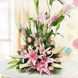 This is an arrangement of 6 Pink Lilies and 12 Pink Roses. This is a pretty pink way of making people feel special. Perfect gift for all age groups and all occasions., Flowers to Bangalore