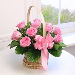 This round basket of roses has been curated as a perfect gift for your partner. The number of roses is 12, Flowers to Bangalore